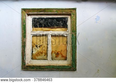 A Very Very Old Window In An Old Wall Of An Old House