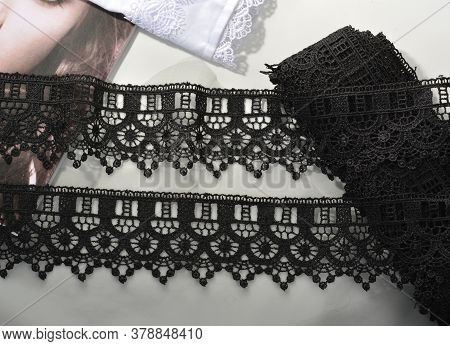 Tapes Of Black Gentle Guipure, Beauty Lace Fabric On Light Background. Elastic Material. Using For A