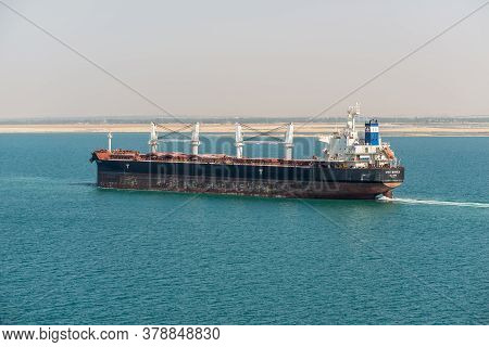 Suez, Egypt - November 14, 2019: Bulk Carrier Vessel Star Monica Passing Suez Canal In Egypt. The Su