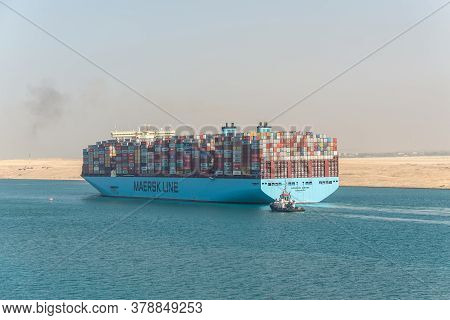 Suez, Egypt - November 14, 2019: Large Container Vessel Ship Moscow Maersk Passing Suez Canal In The