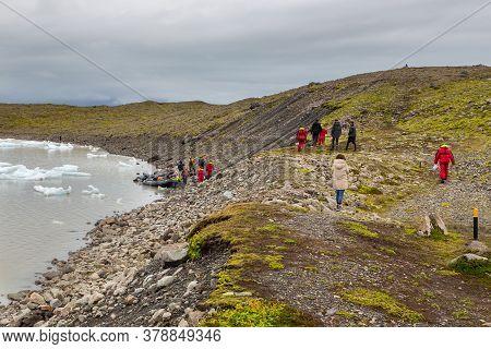 Fjallsorlon Glacial Lagoon, Iceland- 23 August 2015: Tourists Visiting The Lagoon On Pontoons. Glaci