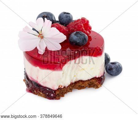 Cheesecake With Fresh Blueberries And Raspberries, Blueberry Jam And Jelly Isolated On White Backgro