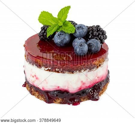 Cheesecake With Fresh Blueberries And Blackberries, Mint, Blueberry Jam And Jelly Isolated On White