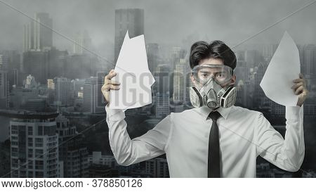 Young Businessman Wears The Gas Masks On City Background While Worst Air Quality,  Serious Problem T