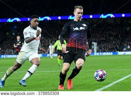 London, England - February 19, 2020: Steven Bergwijn Of Tottenham And Lukas Klostermann Of Leipzig P