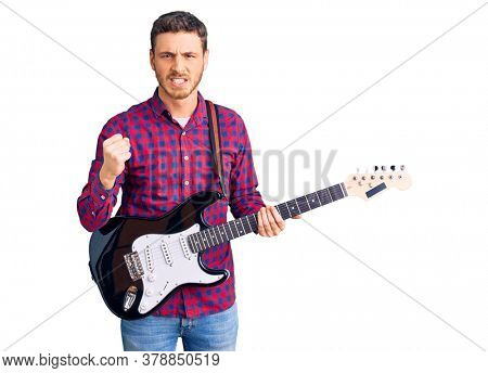 Handsome young man with bear playing electric guitar annoyed and frustrated shouting with anger, yelling crazy with anger and hand raised