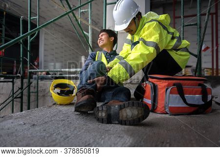 Accident At Work Of Construction Worker At Site. Builder Accident Falls Scaffolding On Floor, Safety