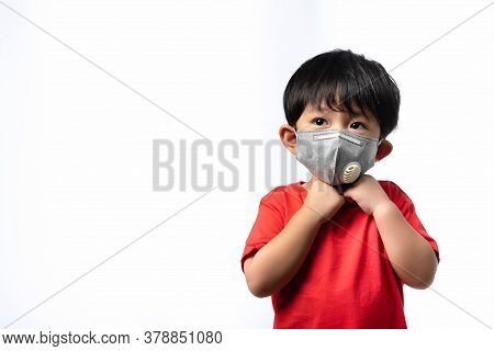 Portrait Asian Little Boy Wears A Mask On White Background With Copy Space For Text, Worst Air Quali