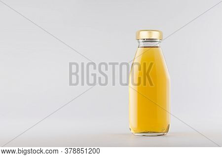 Yellow Apple Juice In Glass Bottle With Gold Cap  Mock Up On White Background With Copy Space, Templ