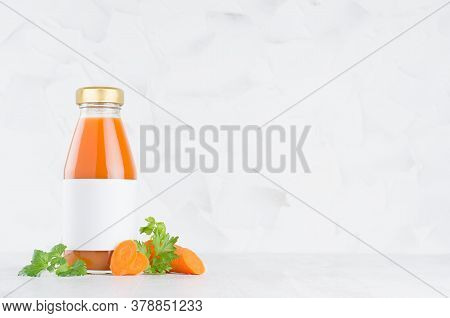 Fresh Vegetable Orange Carrot Juice In Glass Bottle With Blank Label Mock Up With Green Parsley, Sli