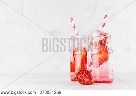 Fresh Summer Cocktails With Ripe Strawberry, Soda, Straw, Ice Cubes On Elegant Soft Light White Wood