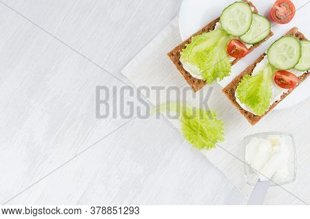 Healthy Dietary Breakfast Of Crisps Rye Flat Toast With Fresh Vegetables - Green Salad, Cucumber, To