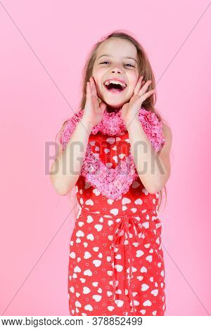 Romantic Love Concept Sweetheart Child With Long Hair Smiling In Red Dress.
