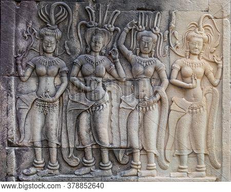 Bas-relief Of Female Spirits (apsaras) At Angkor Wat - Siem Reap, Cambodia