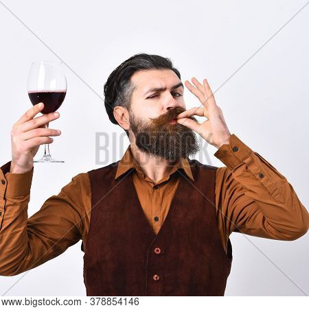 Barman With Satisfied Face Holds Italian Alco Drink