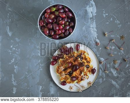 Bucket With Ripe Gooseberries, Waffles With Chocolate Topping, Sprinkled With Gooseberries