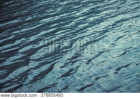 Texture Of Purple Calm Water Of Mountain Lake. Meditative Ripples On Water Surface. Nature Minimal B