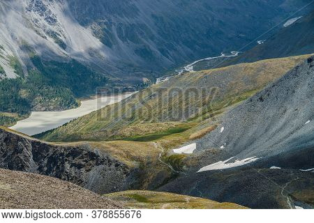 Awesome Aerial View To Beautiful Valley With Mountains Lake And Giant Textured Slopes With Forest. A