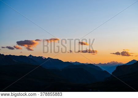 Colorful Dawn Landscape With Beautiful Mountains Silhouettes And Golden Blue Gradient Sky With Cloud