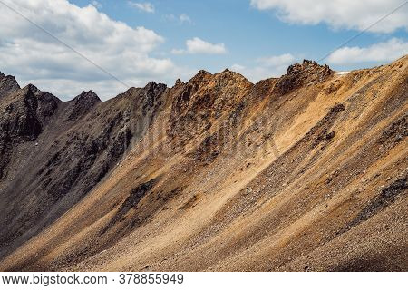 Atmospheric Landscape With Rocky Mountain Wall With Pointy Top In Sunny Gold Light. Beautiful Golden