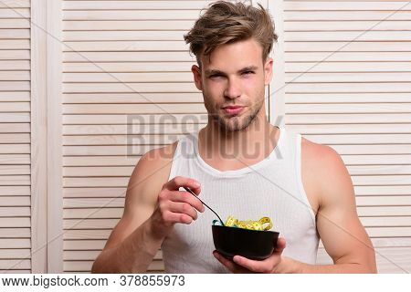 Man Holds Bowl With Measuring Tape Athlete With Messy Hair And Unshaved Face.