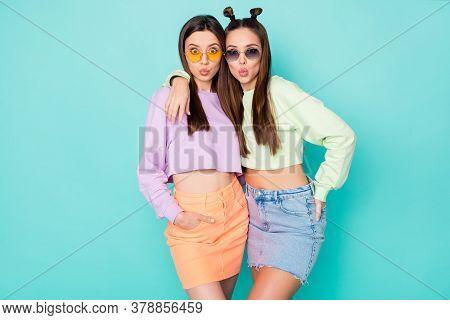 Photo Of Two Funny Flirty Ladies Hugging Sending Boyfriends Air Kisses Wear Sun Specs Green Violet P