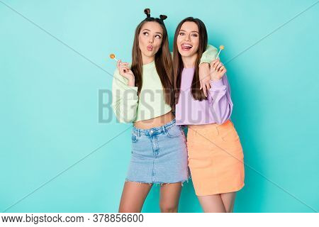 Photo Of Two Funny Lady Hold Lollipop Chupa Chups Sweets Addicted Send Kiss Lick Lips Wear Cropped P