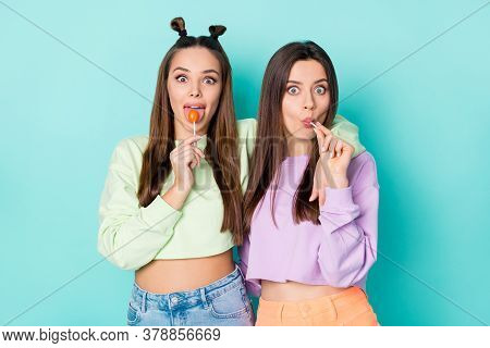 Photo Of Two Crazy Funny Cheerful Ladies Hold Lollipop Chupa Chups Hands Childish Mood Tasty Sweets