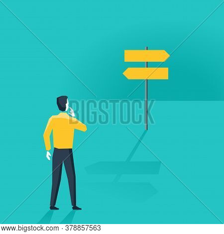 Confused Man Looking At A Roadsign (signboard) With Keft And Right Different Directions -  Difficult