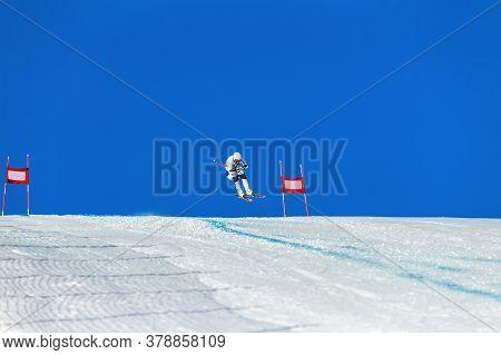 Alpine Skiing Race. Athlete Skiing Between Red Gates