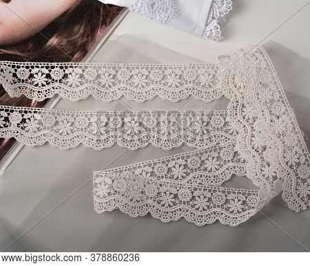 Tapes Of Ecru White Guipure, Beauty Silk Lace Fabric On Light Background. Elastic Material. Using Fo