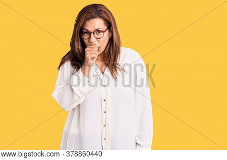Middle age latin woman wearing casual clothes and glasses feeling unwell and coughing as symptom for cold or bronchitis. health care concept.