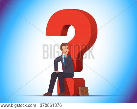 Puzzled Business Man Sitting On A Question Mark