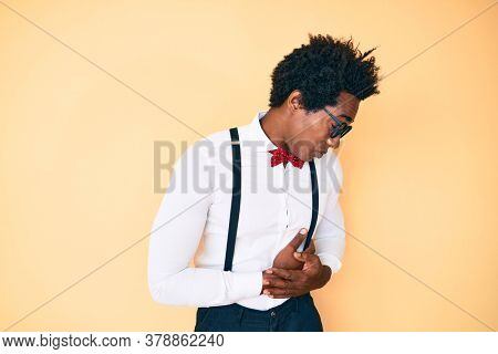 Handsome african american man with afro hair wearing hipster elegant look with hand on stomach because indigestion, painful illness feeling unwell. ache concept.