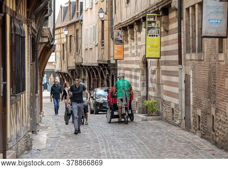 Troyes, France - August 31, 2018: Tourists Exploring The Narrow Streets Of Medieval Troyes Old Town,