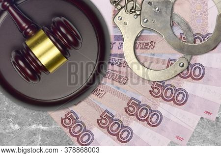 500 Russian Rubles Bills And Judge Hammer With Police Handcuffs On Court Desk. Concept Of Judicial T