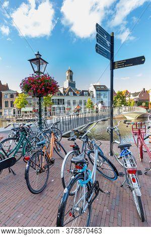 Leiden, Netherlands - July 21, 2020: Cityscape Leiden With Catharinabridge, Waterways, Bicyles And H