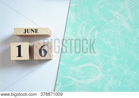 June 16, Empty White - Green Background With Number Cube.