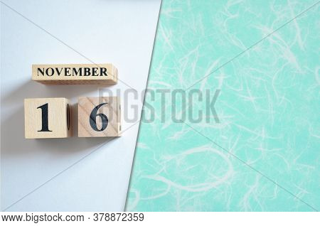 November 16, Empty White - Green Background With Number Cube.