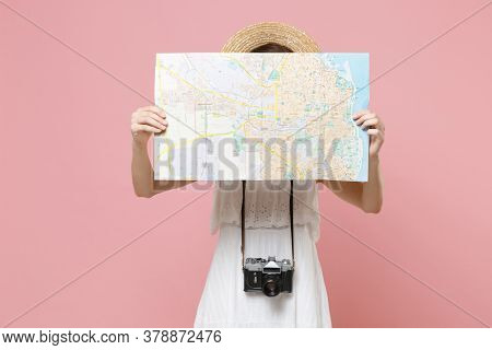 Young Tourist Woman In Summer White Dress Hat With Photo Camera Isolated On Pink Background. Female