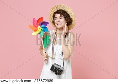 Smiling Young Tourist Woman In Dress Hat With Photo Camera Isolated On Pink Background. Traveling Ab