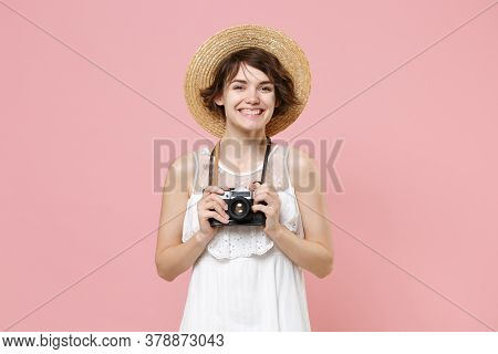Smiling Young Tourist Woman In Summer Dress Hat Isolated On Pink Background. Traveling Abroad To Tra
