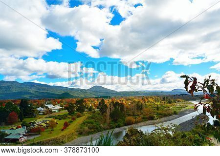 Bright Autumn Colours In Turangi Town On The Banks Of Tongariro River And Magnificent Mountains In T