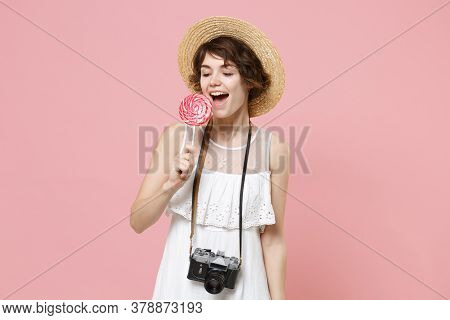 Cheerful Young Tourist Woman In Summer Dress Hat With Photo Camera Isolated On Pink Background In St