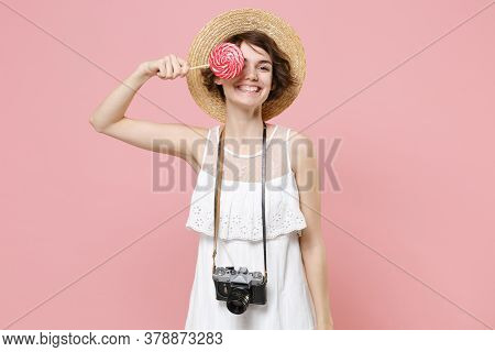 Smiling Young Tourist Woman In Summer Dress Hat With Photo Camera Isolated On Pink Background. Trave