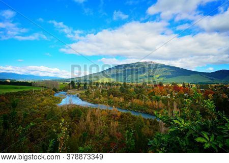 Colourful Autumn Landscape Of Tongariro River Delta With Magnificent Mountains At The Horizon. North