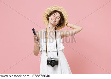 Smiling Tourist Woman In Dress Hat With Photo Camera Isolated On Pink Background. Traveling Abroad T