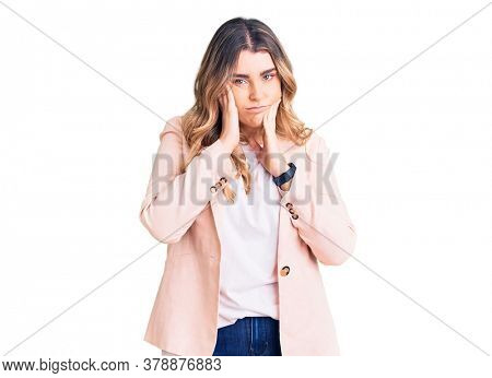 Young caucasian woman wearing business clothes tired hands covering face, depression and sadness, upset and irritated for problem