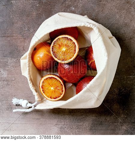 Blood Sicilian Oranges, Ripe And Juicy, In Cotton Eco Friendly Bag, Whole And Sliced, Over Grey Conc