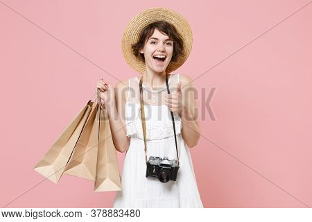 Excited Tourist Girl In Dress Hat With Photo Camera Isolated On Pink Background. Traveling Abroad To